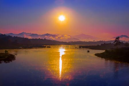 Beautiful sunset on Thailand beach on bridgeSunset on river  and bridge 写真素材