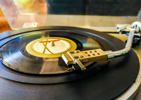 grooves: Old turntable with a record in playing Stock Photo