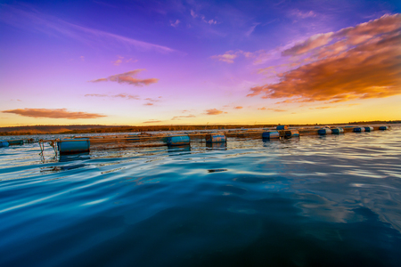 Fish farms in Khong river with clear blue sky