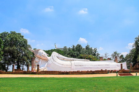 Reclining Buddha is a statue that represents Buddha lying down and is a major iconographic and statuary pattern of Buddhism at Wat Yai Chai Mongkol Ayutthaya historical park Thailand Stock Photo