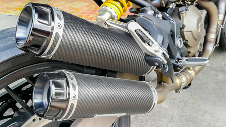 Closeup of exhaust or intake of racing motorcycle. Low angle photograph of motorcycle
