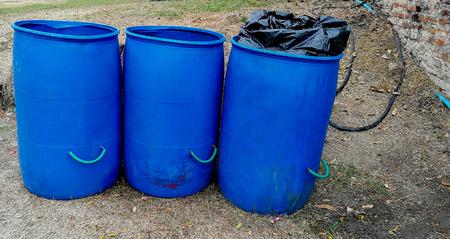 trash can (garbage bin) on green grass field in public park Stock Photo