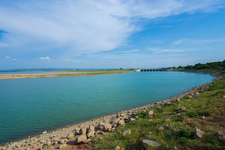 A dried up empty reservoir or dam during a summer heatwave, low rainfall and drought in thailand Stock Photo