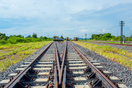 Rusty track rails. The railway track itself is new, the rails rust from time because there are no trains running through them Stock Photo
