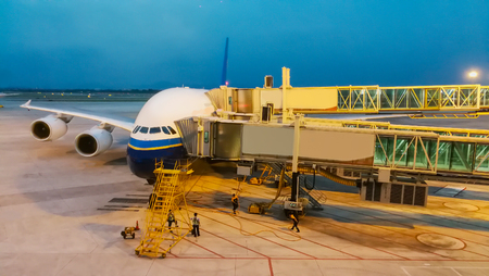 Technical inspectors are inspecting large aircraft at Guangzhou International Airport, China