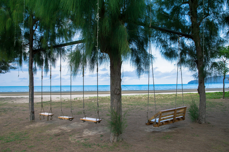 Wooden swing at seaside summer in Thailand. 스톡 콘텐츠