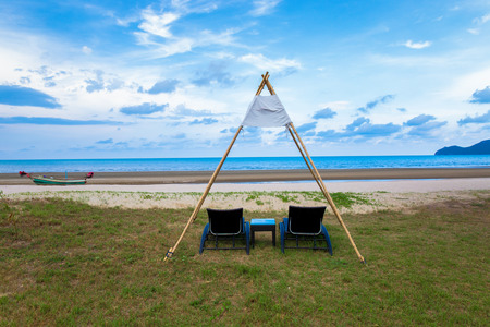 Empty beach with blue sea and beach beds in the morning Foto de archivo
