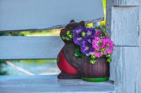 vase of white and purple flowers, elegant feminine bouquet of flowers