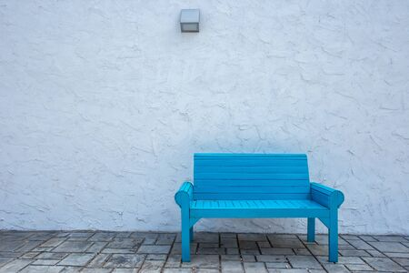 old shabby blue bench in the countryside