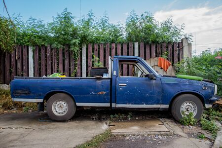 Blue old pickup truck out in the country