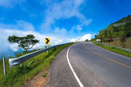 Mountain road. Summer time. Background, travel, landscape. Highway in the mountains. Good asphalt road with beautiful views. Transport