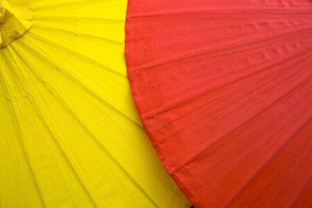 The close-up of the umbrella from the top has bamboo as a structure and colored fabric as an umbrella for decoration. And is a beautifully arranged background