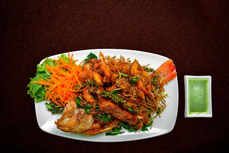Fried fresh big fish with salad and hot spicy sauce, thai food style concept