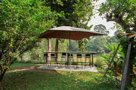 Vintage dining benches with canopy to shade the river in rural Thailand Zdjęcie Seryjne