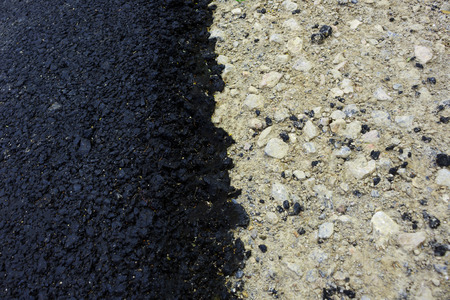equate: Texture of black fresh and grey old layers of asphalt on road surface