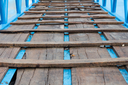 joists: Wide angle wooden bridge with rusted joists in woods Stock Photo