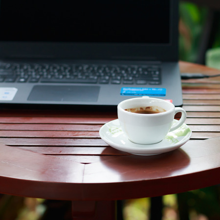 cappaccino: Coffee cup on wood table