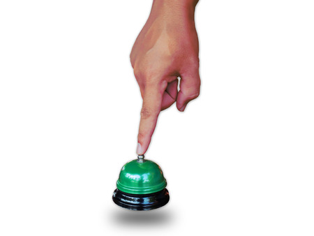 attract attention: Hand man push hotel bell  on white.