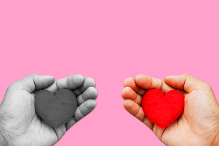 love declaration: Hand hold red heart and black and white picture on pink background concept love.