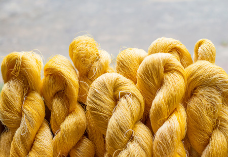 Handmade yarn from the cocoons. Standard-Bild - 106276996