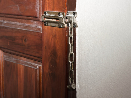 rusty padlock: Old-styled door lock with chain.