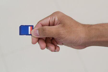 hand holding sd memory card. Foto de archivo