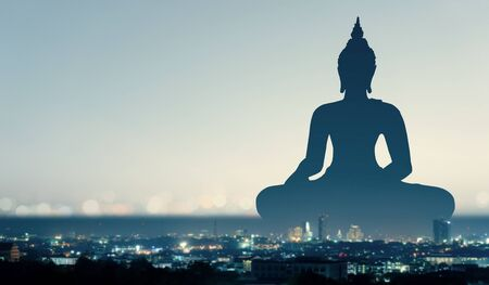 Double exposure of Buddha ,  religion and city concept