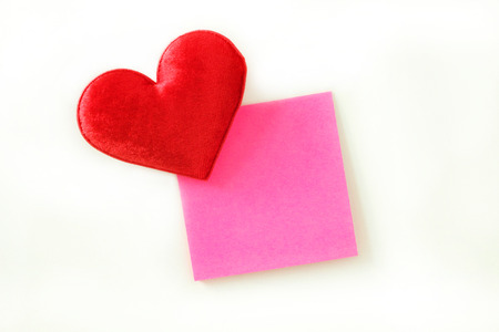 postit note: Pink post-it note and Red fabric heart Stock Photo