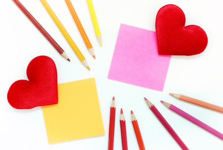 postit note: Color post-it note with Red fabric hearts and color pencil Stock Photo