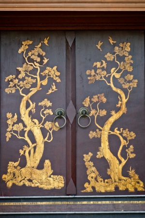 The beautiful ancient door in Thai style photo