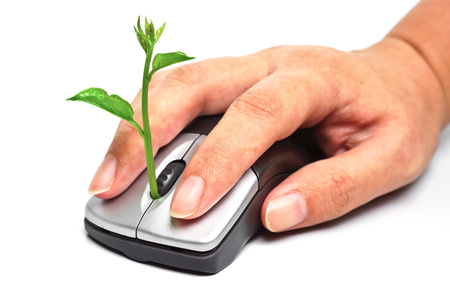 carbon emission: hands using a mouse with a tree   green it Stock Photo