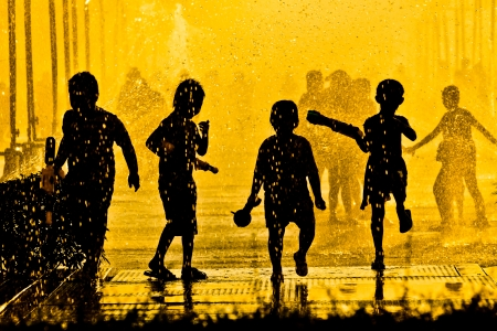 children playing in water silhouette
