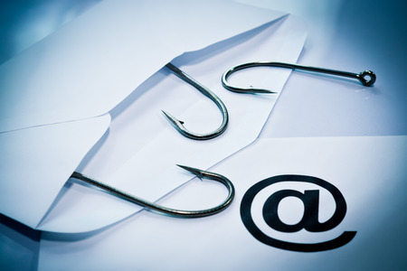 spam mail: phishing   fish hook in an envelope   email phishing   spam mail   computer threats