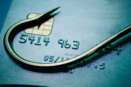phishing   fish hook on a credit card   computer threats   cyber crime photo