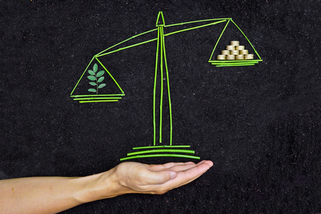 csr: Tree and money to balance scales on soil background     csr   corporate social responsibility   business ethics