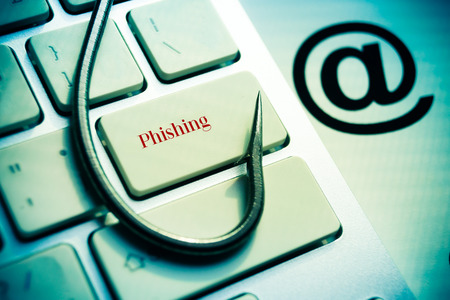 cyber crime: phishing   a fish hook on computer keyboard with email sign   computer crime   data theft   cyber crime