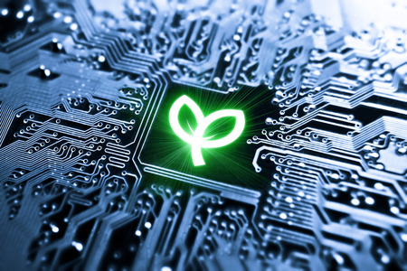 green computing: symbol of a leaf on computer circuit board - Green IT - Green computing