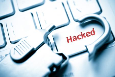 broken security lock on computer keyboard - hacking issue