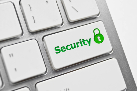 security symbol on computer keyboard with green padlock photo