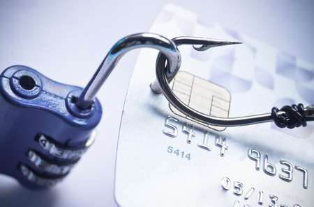 credit card with open security lock - risk of data theft using phishing method photo