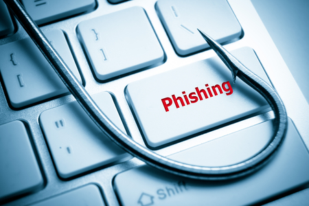phishing   a fish hook on computer keyboard   computer crime   data theft   cyber crime photo