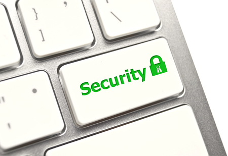 security symbol on white computer keyboard with green padlock photo