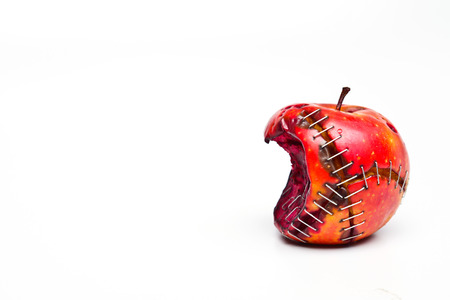 apple gmo: bitten and sewed gmo apple