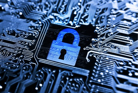 security lock symbol on computer circuit board Stock Photo