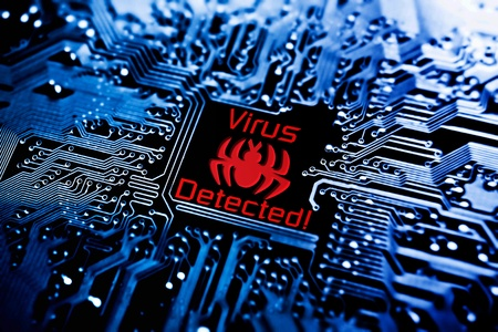 computer virus sign on circuit board Stock Photo
