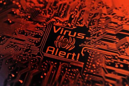 computer virus sign on circuit board Stock Photo