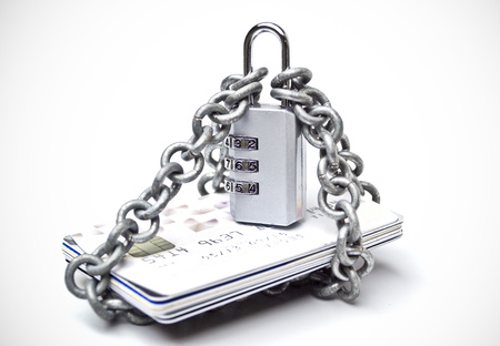 internet fraud: chained credit cards security lock with password - phishing protection concept