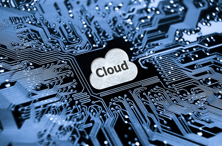 symbol of a cloud on computer circuit board - cloud computing photo