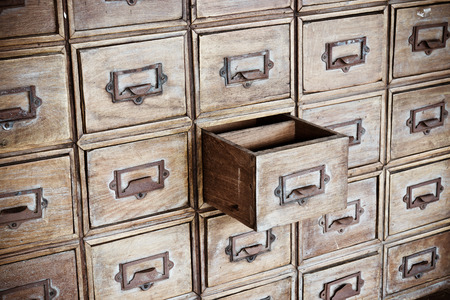 opened old chest of drawers photo