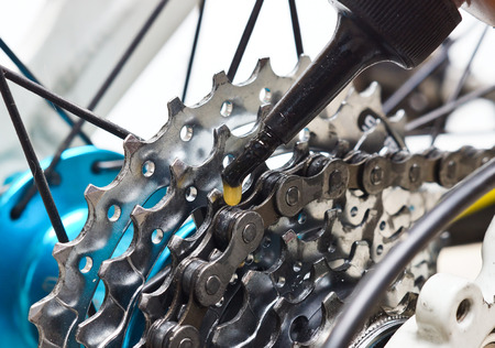 lubricate: lubricate bicycle cassette with oil Stock Photo